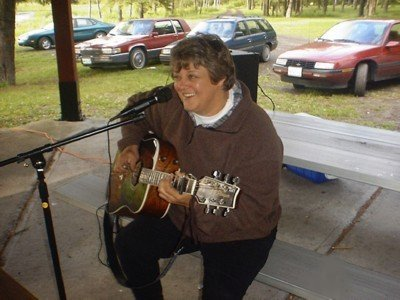 Cathy Cowette, singer and fingerstyle guitar player